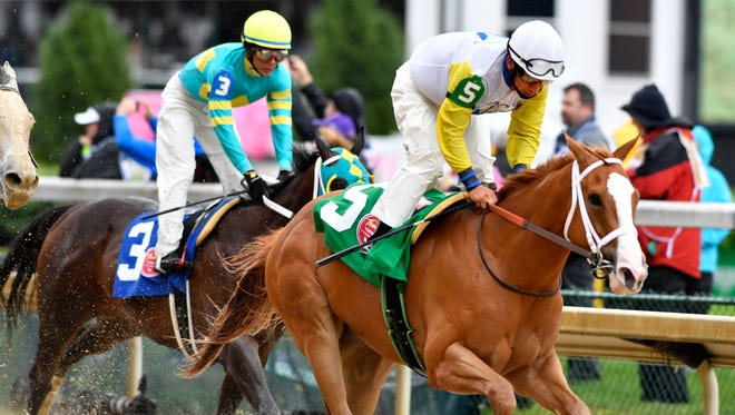 Northwest Bourbon with Paco Lopez aboard (right) finishes first Friday in the Blushing KD on Oaks Day at Churchill Downs. (Photo by David Lee Hartlage, Special to The Courier-Journal) May 5, 2017