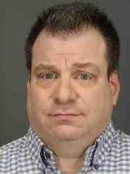 Eric Jackier, 48, is accused of swindling $167,000