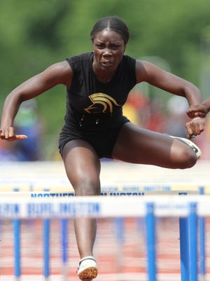 Isabelle Dely, of Paramus Catholic, competes in the 100 meter high hurdles, in a time of 14,47. Saturday, June 9, 2018