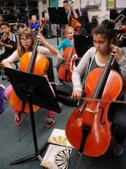 In this 2014 file photo, Jesalyn Henson, left, and Isabella Argueta play in the Tulare County Junior Strings.