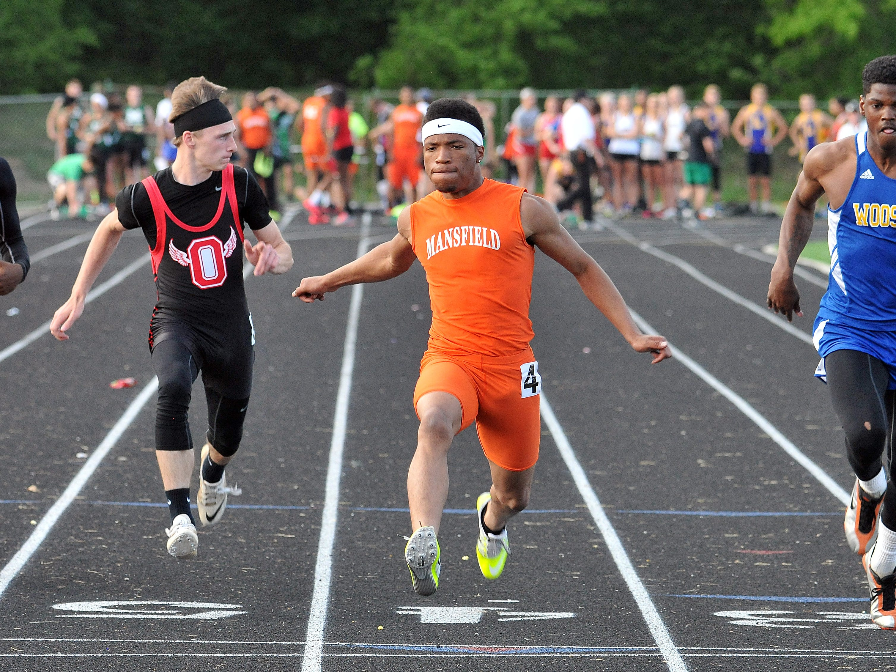 Mansfield Senior's Jacquez Wellington crosses the finish line during the boys 100 Meter Dash at Madison High School Friday.