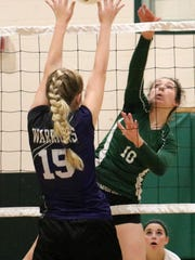 Cloudcroft's Laci Toddy, right, spikes a ball in between the hands of Gateway Christian's Emily Turner.