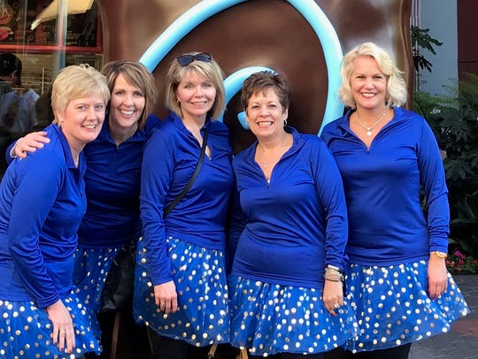 "A group of Iowa moms knows as the ""5K Virgins"" try"