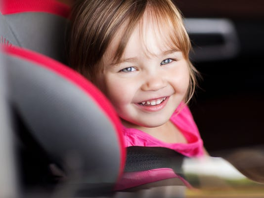 Little Girl in Baby Car Seat