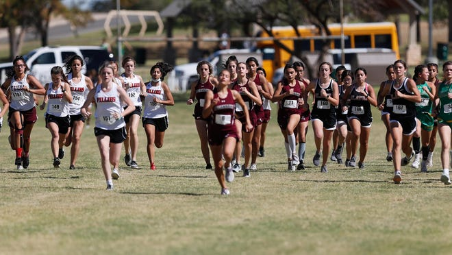 Shallowater and Abernathy begin the two-mile ahead of the pack of runners during the District 2-3A Cross Country Meet on Monday at Mae Simmons Park.