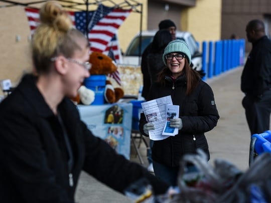 Nicki Heil, fundraising assistant for We Agape You, works to raise money for homeless and unemployed veterans Thursday, Jan. 21, 2016, outside the Lebanon Wal-Mart. WAY's program concentrates on employment training, housing assistance and automobile purchase assistance.