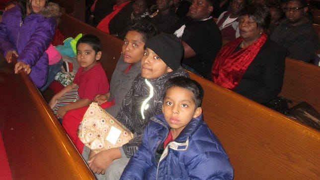 More than 200 people attended a holiday party at the Bethel A.M.E. Church in Paterson on Sunday, where Christmas gifts were distributed to children.