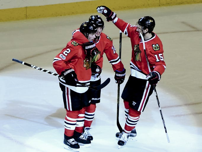 Blackhawks defenseman Duncan Keith (2) celebrates his