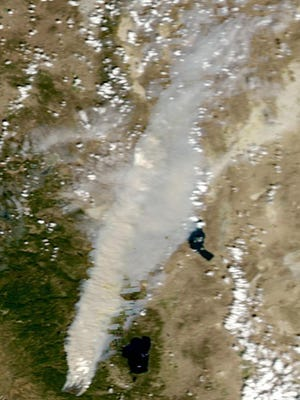 This NASA photo from Wednesday shows King Fire smoke extending well past Pyramid Lake into Northern Nevada.