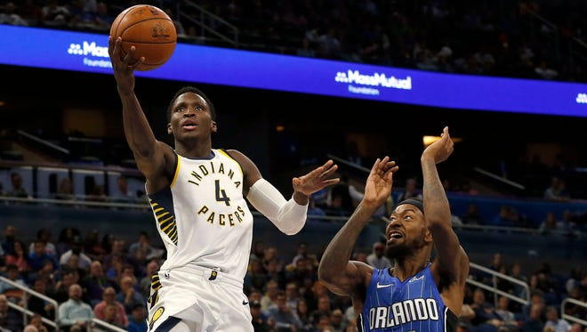 Nov 20, 2017; Orlando, FL, USA; Indiana Pacers guard Victor Oladipo (4) shoots a layup as Orlando Magic guard Terrence Ross (31) defends during the second quarter at Amway Center. Mandatory Credit: Kim Klement-USA TODAY Sports