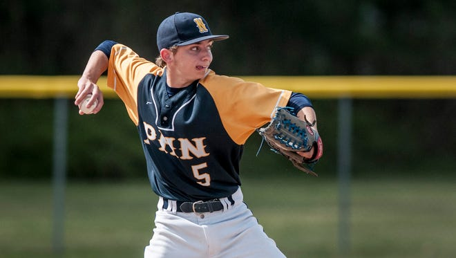 Port Huron Northern's Chase Moeller throws to first for an out during a baseball game Thursday, May 18, 2017 at Port Huron Northern High School.