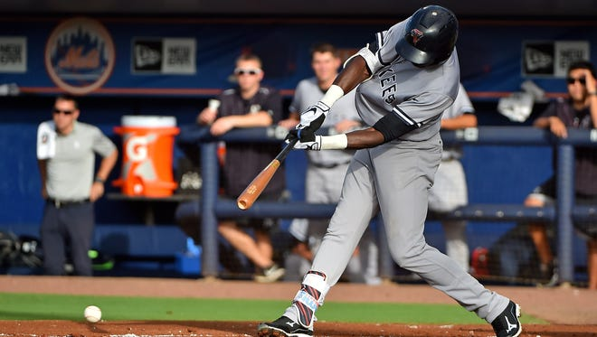 Tampa Yankees center fielder Estevan Florial (34), here connecting on an RBI single in the first inning against the St. Lucie Mets at First Data Field last August, will be in camp for the Yankees this spring.