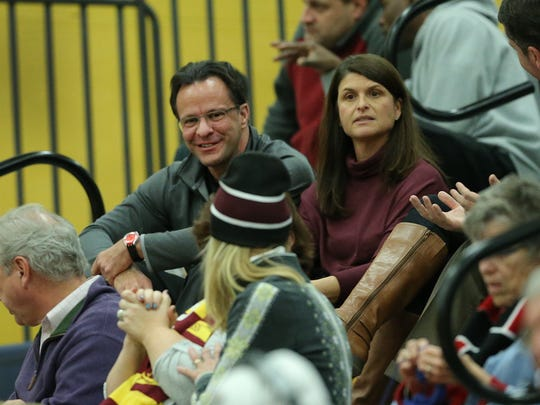 Tom Crean and his wife Joani take in the Mooresville-Bloomington North game on Feb. 9, 2016, at Moorseville High School. Their son Riley played for the Cougars.