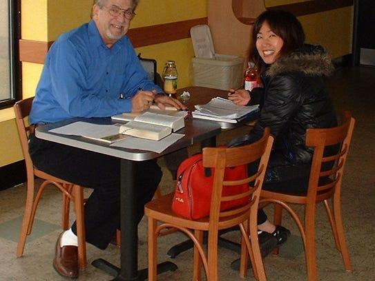Gary Myers tutors Mira Sim (from Seoul, Korea) as part