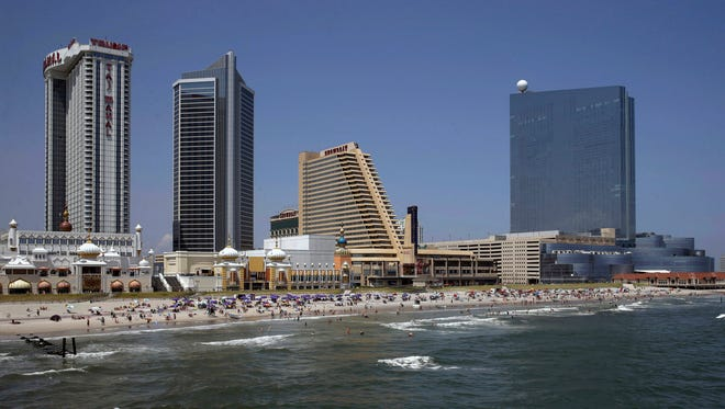 FILE - In this July 23, 2014 file photograph, the Revel Casino Hotel, right, stands along the Boardwalk near Trump Taj Mahal Casino, left, with its Chairman Tower, and the Showboat Casino Hotel, second right, in Atlantic City, N.J.