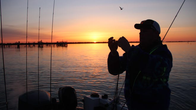 As the sun rises, Brian Settele of Menomonee Falls prepares for a day of fishing at South Shore County Park public boat launch on the Milwaukee shore of Lake Michigan.