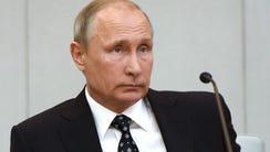 Russian President Vladimir Putin listens during the