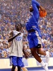 Hamidou Diallo, right, shoots near Wenyen Gabriel during UK's Big Blue Madness at Rupp Arena.