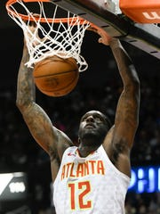 Atlanta Hawks forward Taurean Prince dunks against the Philadelphia 76ers during the first half of an NBA basketball game Friday, March 30, 2018, in Atlanta. (AP Photo/John Amis)
