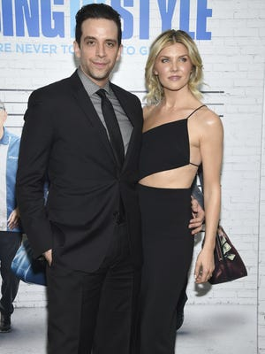 "FILE - In this March 30, 2017, file photo, actor Nick Cordero, left, and Amanda Kloots attend the premiere of ""Going in Style"" in New York. Tony Award-nominated actor Cordero, who specialized in playing tough guys on Broadway has died in Los Angeles after suffering severe medical complications after contracting the coronavirus. He was 41. Cordero died Sunday, July 5, 2020, at Cedars-Sinai hospital after more than 90 days in the hospital, according to his wife, Amanda Kloots."
