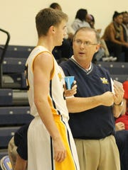Moeller coach Carl Kremer has a discussion with senior