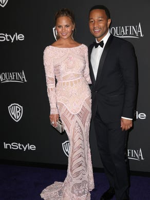 John Legend and his wife Chrissy Teigen celebrate his