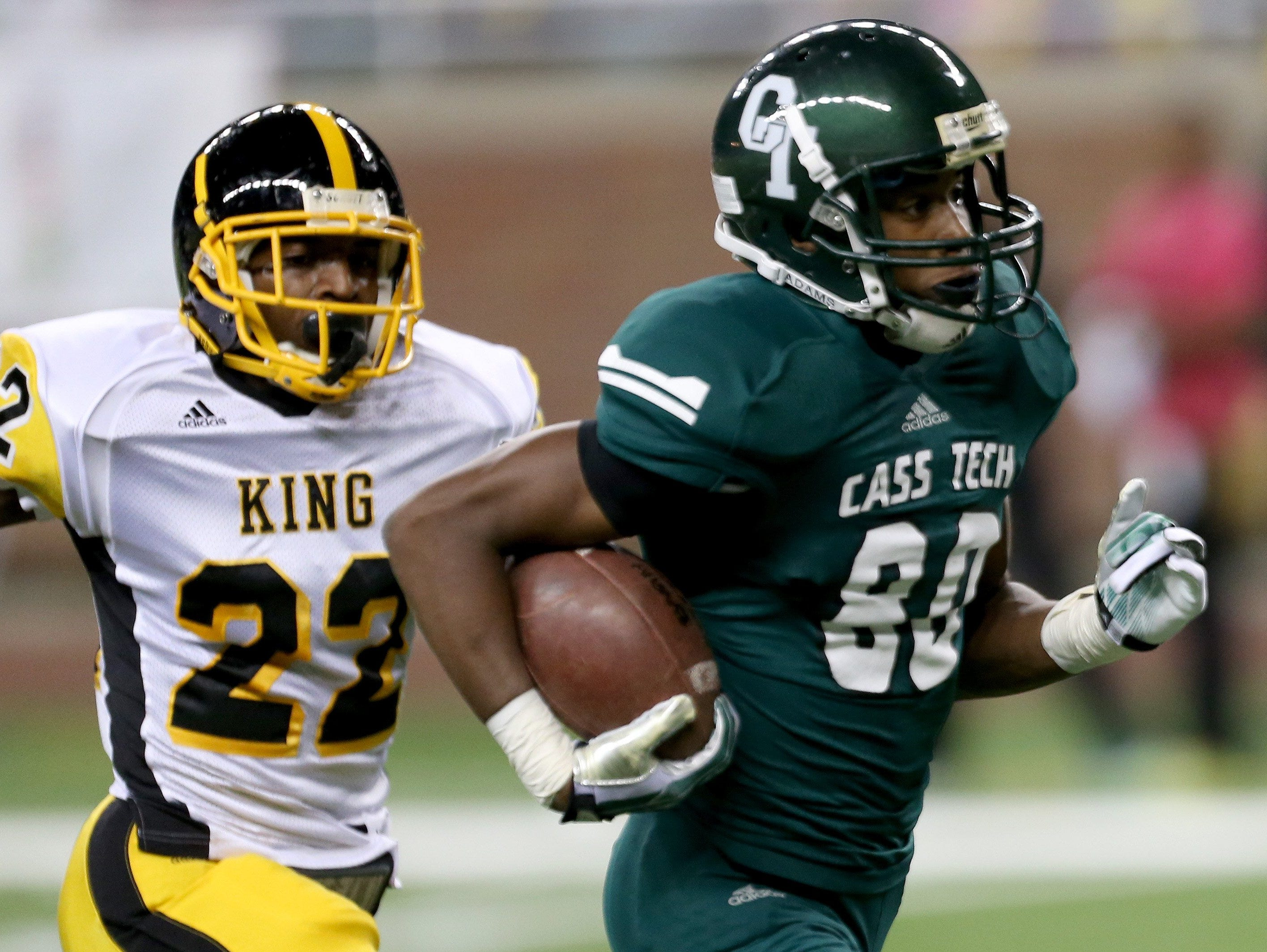 Donovan Peoples-Jones runs by Detroit King's Jalen Embry for a TD in a 2013 game at Ford Field in Detroit.