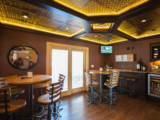 A pub room leads to an outside patio.