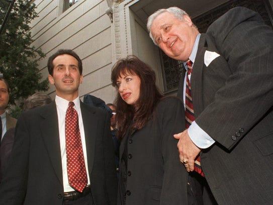 Paula Jones with her lawyers, Joseph Cammarata, left,