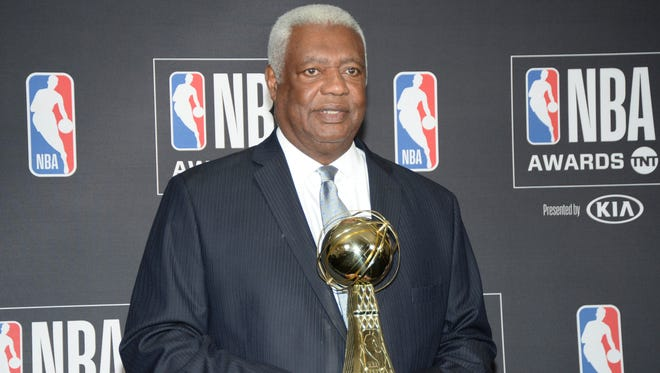 Former NBA player Oscar Robertson poses for photos with his lifetime achievement award during the NBA Award Show at Barker Hanger.