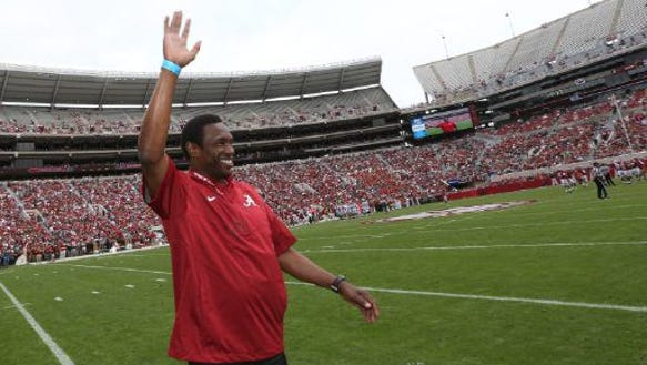Avery Johnson waves to the crowd at Alabama's A-Day