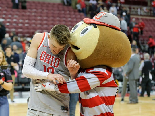 Ohio State Buckeyes forward Justin Ahrens celebrates