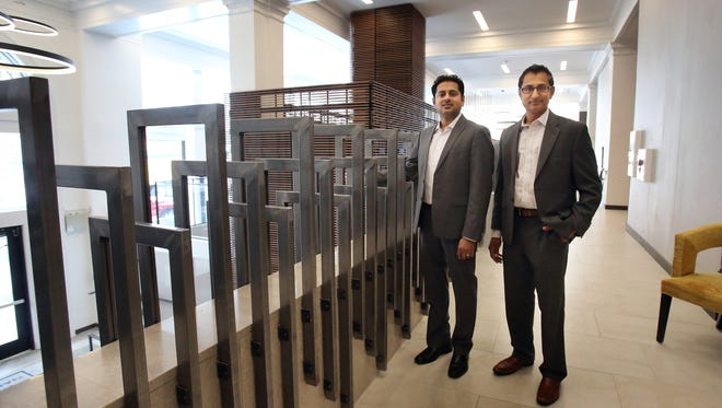 Jay Kumar (left) and Snay Patel recently completed their first joint venture, Hotel Napoleon. Located at 179 Madison, the hotel is a 58-room conversion of the historic Scimitar Building. It's part of a boom in hotel rooms in the Downtown market, but it's the only current project that adaptively re-used a historic building.