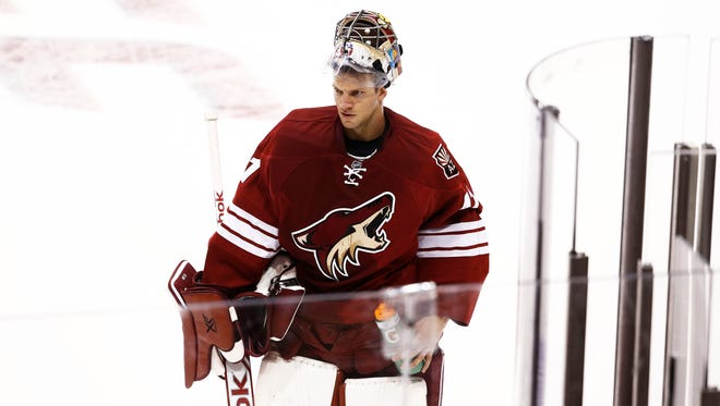 Arizona Coyotes goalie MIke Smith gives up six goals to the Winnipeg Jets during the season opener on Thursday, Oct. 9, 2014 at Gila River Arena.