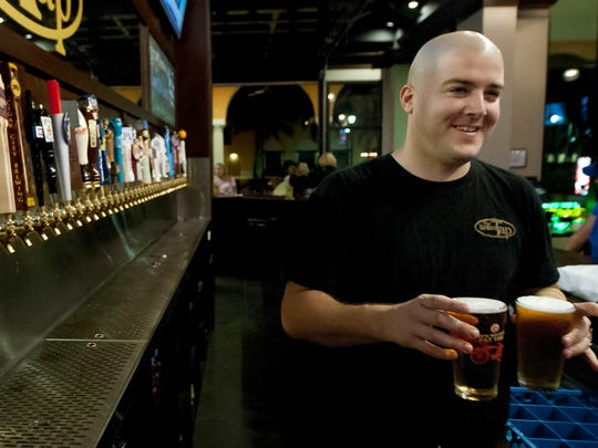 Ryan Sisko serves up brew Wednesday at The Brass Tap at Coconut Point in Estero.