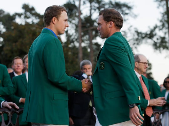 Danny Willett (right) is greeted by Jordan Spieth (left) after Willett won the  Masters on April 10.