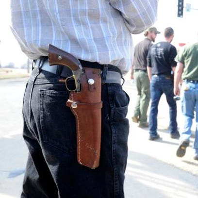 A Mountain Home man openly carries a pistol during an open carry demonstration in this March 2014 photograph.