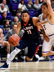 Belmont guard Kevin McClain (11) advances with Lipscomb
