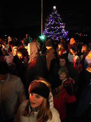 A large crowd attends the Town of Stony Point Christmas tree lighting ceremony at Kirkbride Hall