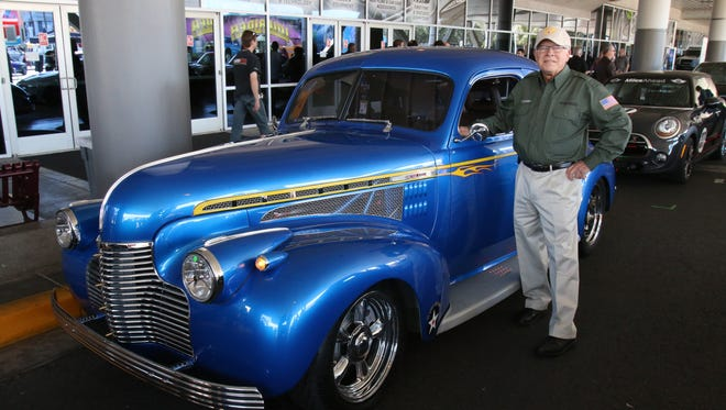 John Callies, of Memphis, poses with his 1940 Chevy at the SEMA show in Las Vegas