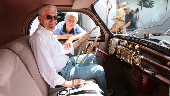 Jack and Cindy Jones pose with their 1941 Lincoln V12 Zephyr Coupe, which has gold plating in the interior.