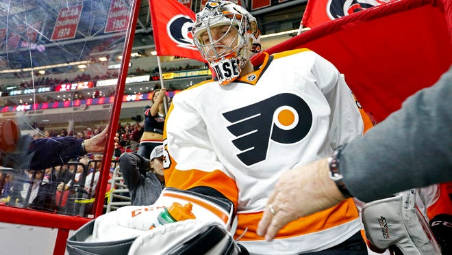 Philadelphia Flyers goalie Steve Mason (35) before the start of the second period against the Carolina Hurricanes at PNC Arena.