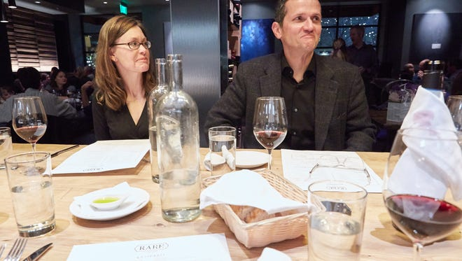 Diners Gayle Hemenway and Franco Basile discuss their previous experiences with Italian food during dinner at RARE Italian Sunday, January 11, 2015.