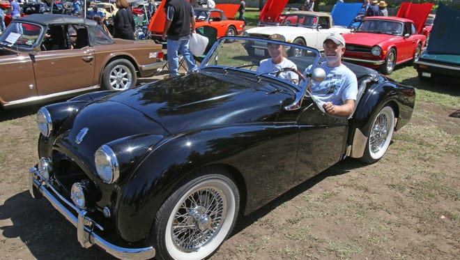 Joel and Pam Justin of Camarillo, Calif., in their Triumph TR2 at the Queen's English car show in Los Angeles