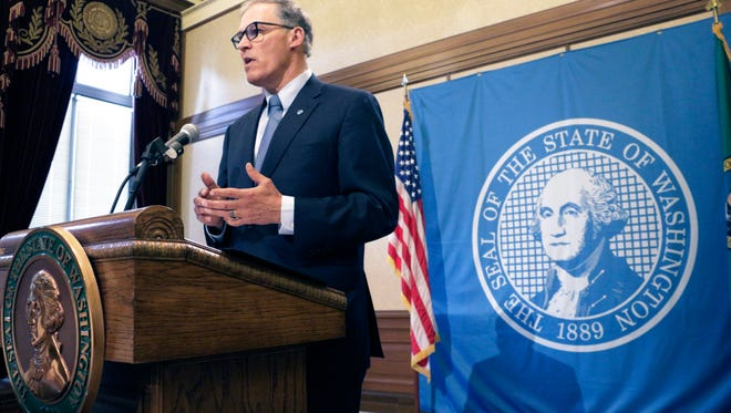 Washington Gov. Jay Inslee talks to the media about the status of ongoing state budget negotiations, Friday, June 19, 2015, in Olympia, Wash. Inslee says new taxes are off the table, and he encouraged the House and Senate to consider closing some tax exemptions as a compromise. (AP Photo/Rachel La Corte)