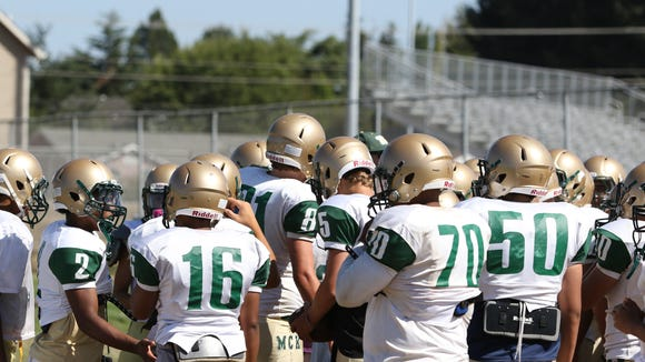 Players participate in practice on Friday, Aug. 21, 2015, at McKay High School in Salem.