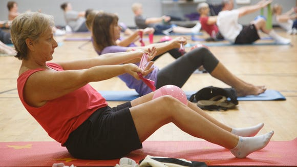 Students go through some of the exercises in Lori Soqui's Healthy Posture Class at the Summit in St. George, Wednesday, Aug. 26, 2015. Soqui uses her training as a pilates instructor to lead her students through an hour long work out in which they focus n improving their posture in order to improve their overall health.