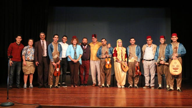 Organizers and participants gather on stage Friday, Sept. 18, 2015, at the Elkader Opera House. These people were part of an annual forum meant to honor Emir Abd el-Kader, the Muslim hero from the 19th century who inspired the Iowa town's name.