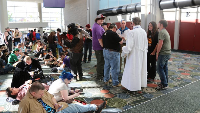 A relatively small group of people await entrance to the 2015 Salt Lake Comic Con on Sept. 24, 2015.