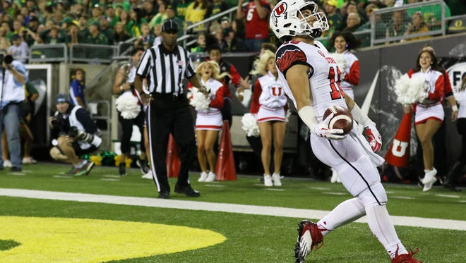 Utah wide receiver Britain Covey (18) scores a touchdown during the second half of the Utes 62-20 thumping of Oregon Saturday.